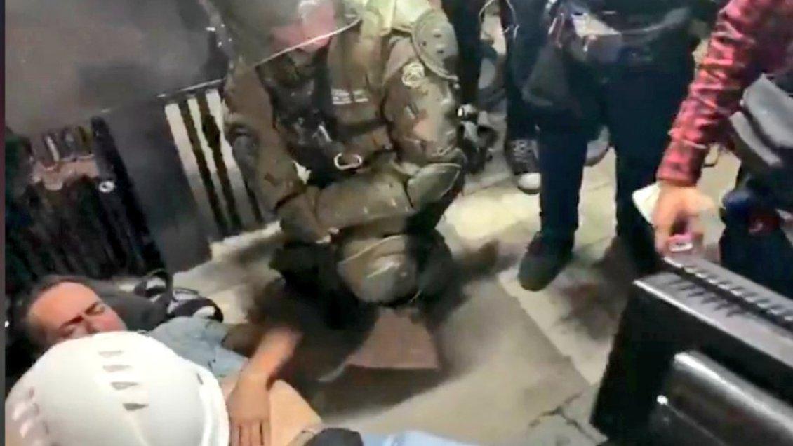 Protestas terminaron con camarógrafo herido por Carabineros en Talca - Cooperativa.cl